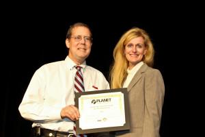 Photo Diaz accepting an award at LANDSCAPES
