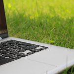 laptop sitting in grass